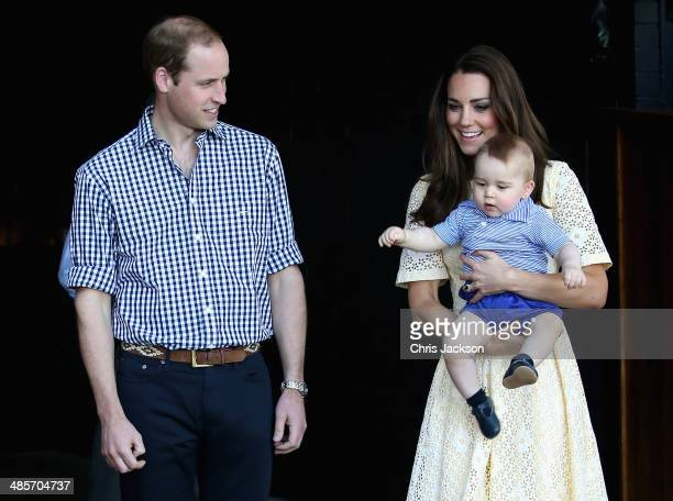 Catherine Duchess of Cambridge holds Prince George of Cambridge as Prince William Duke of Cambridge look whilst meeting a Bilby called George at...