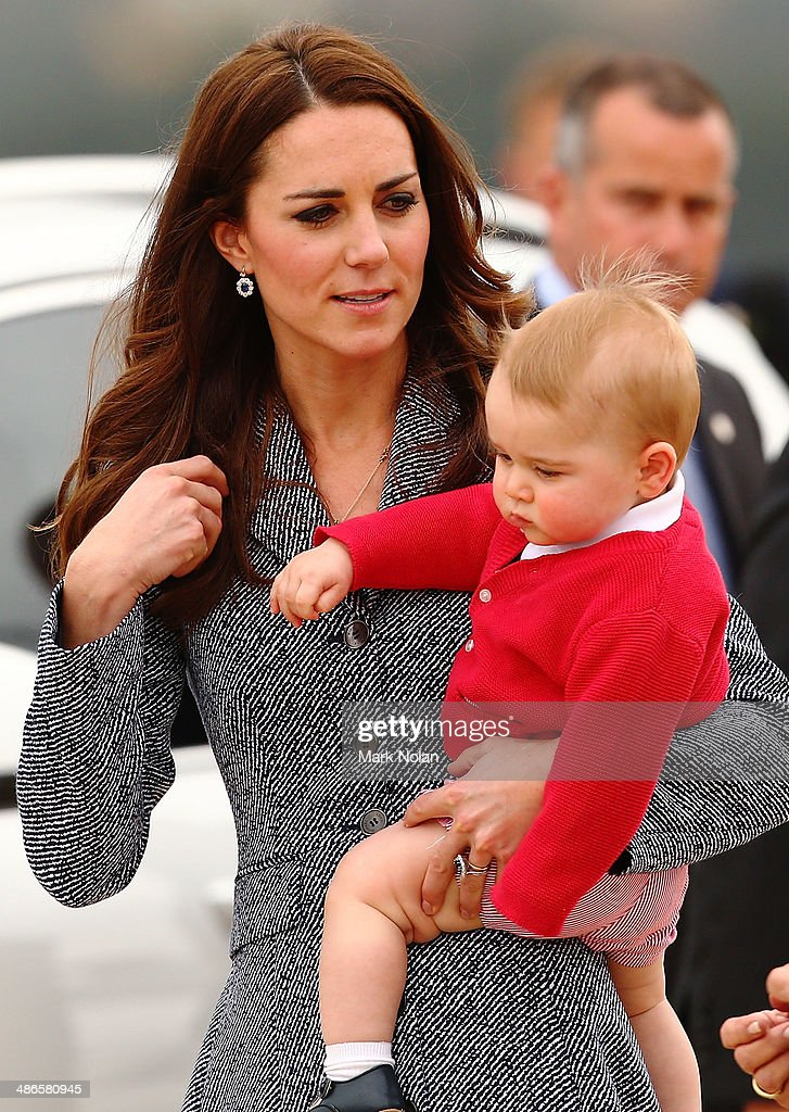 <a gi-track='captionPersonalityLinkClicked' href=/galleries/search?phrase=Catherine+-+Duchess+of+Cambridge&family=editorial&specificpeople=542588 ng-click='$event.stopPropagation()'>Catherine</a>, Duchess of Cambridge holds <a gi-track='captionPersonalityLinkClicked' href=/galleries/search?phrase=Prince+George+of+Cambridge&family=editorial&specificpeople=11176510 ng-click='$event.stopPropagation()'>Prince George of Cambridge</a> before they leave Fairbairne Airbase as they head back to the UK after finishing their Royal Visit to Australia on April 25, 2014 in Canberra, Australia. The Duke and Duchess of Cambridge are on a three-week tour of Australia and New Zealand, the first official trip overseas with their son, <a gi-track='captionPersonalityLinkClicked' href=/galleries/search?phrase=Prince+George+of+Cambridge&family=editorial&specificpeople=11176510 ng-click='$event.stopPropagation()'>Prince George of Cambridge</a>.