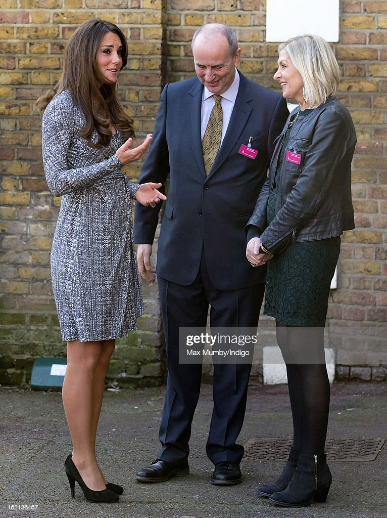 Catherine, Duchess of Cambridge, in her role as Patron of Action on Addiction, is greeted by Nick Barton (C, Chief Executive of Action on Addiction) as she arrives for a visit to Hope House, a residential treatment centre, on February 19, 2013 in London, England.