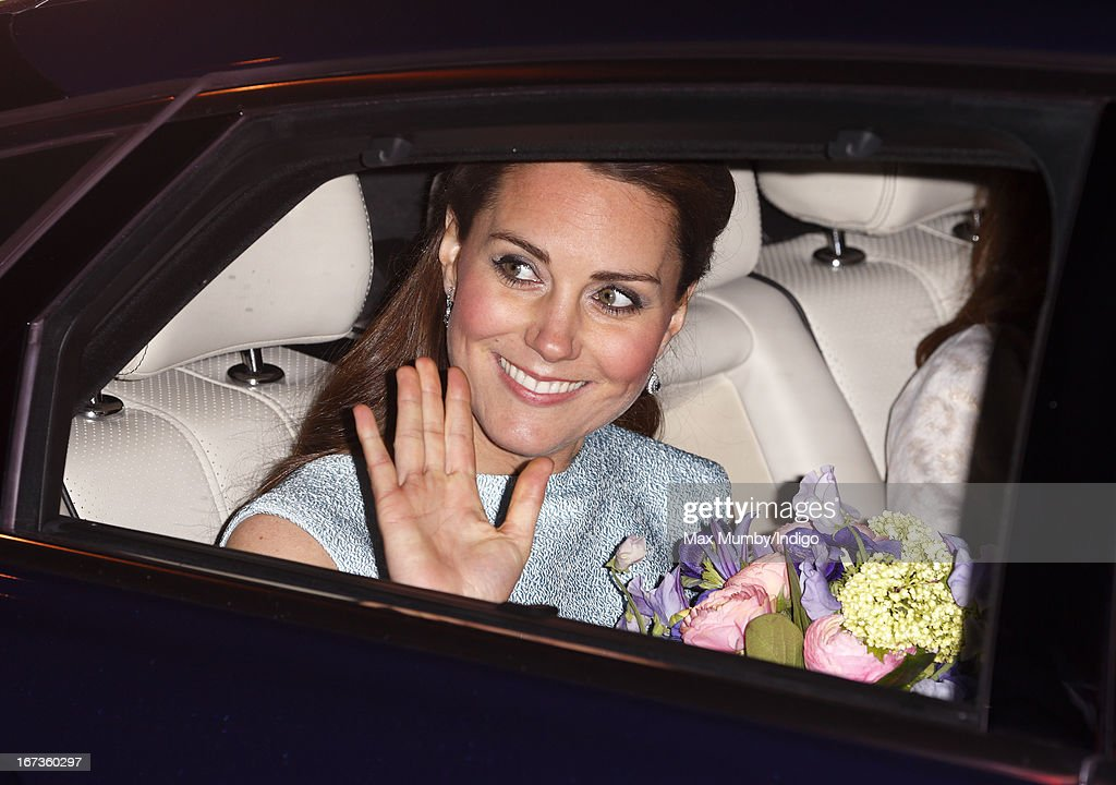 Catherine, Duchess of Cambridge, in her role as Patron of The Art Room, waves goodbye from her car after attending an evening reception to celebrate the work of the charity at the National Portrait Gallery on April 24, 2013 in London, England.