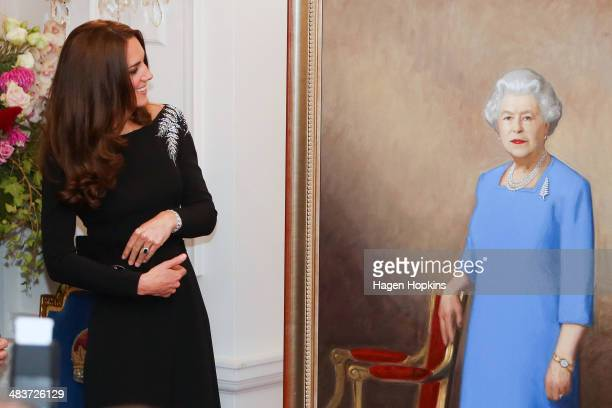 Catherine Duchess of Cambridge inspects a portrait of Queen Elizabeth II painted by New Zealand artist Nick Cuthell and unveiled during a state...