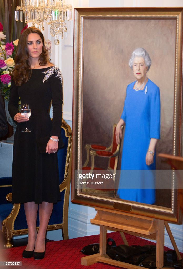Catherine, Duchess of Cambridge inspects a portrait of Queen Elizabeth II, painted by New Zealand artist Nick Cuthell and unveiled at a state reception at Government House on April 10, 2014 in Wellington, New Zealand.on April 10, 2014 in Wellington, New Zealand. The Duke and Duchess of Cambridge are on a three-week tour of Australia and New Zealand, the first official trip overseas with their son, Prince George of Cambridge.