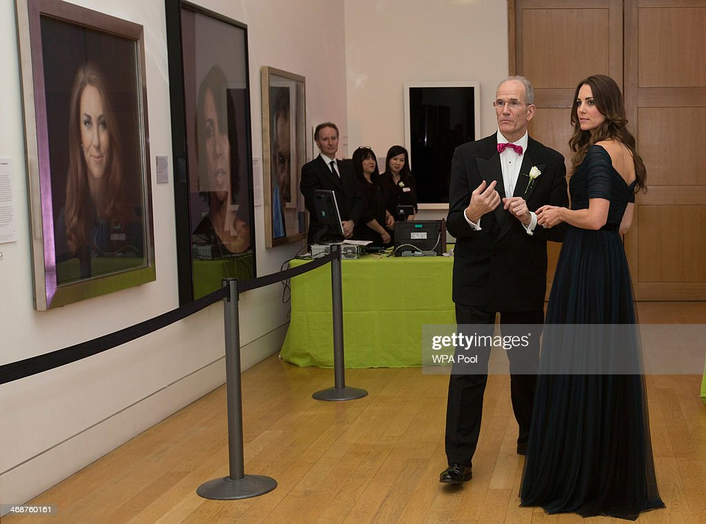Catherine, Duchess of Cambridge is congratulated by the Director of the National Portrait Gallery Sandy Nairne as she attends The Portrait Gala 2014: Collecting To Inspire at National Portrait Gallery on February 11, 2014 in London, England.