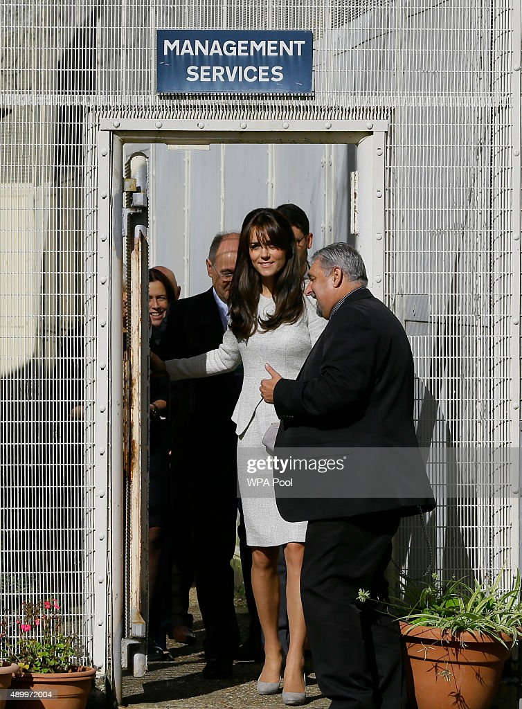 Catherine, Duchess of Cambridge (C) is escorted by Dave Charity (R), Governor of HMP Send during a visit to the Rehabilitation of Addicted Prisoners Trust at HMP Send on September 25, 2015 in Woking, United Kingdom.