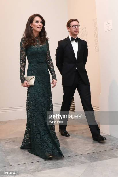 Catherine Duchess of Cambridge is escorted by National Portrait Gallery Director Nicholas Cullinan at the 2017 Portrait Gala at the National Portrait...