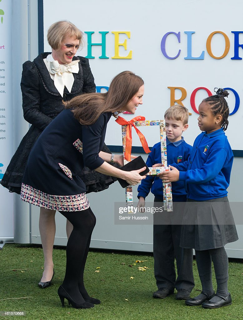 Catherine Duchess of Cambridge is given a chair by children and Grayson Perry as she arrives to officially open The Clore Art Room at Barlby Primary...