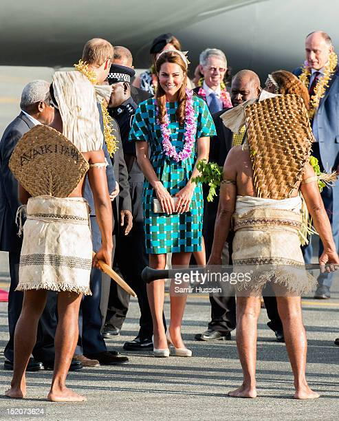 Catherine Duchess of Cambridge is greeted by Island warriors as she arrives at Honiara International Airport on day 6 of the royal couple's Diamond...