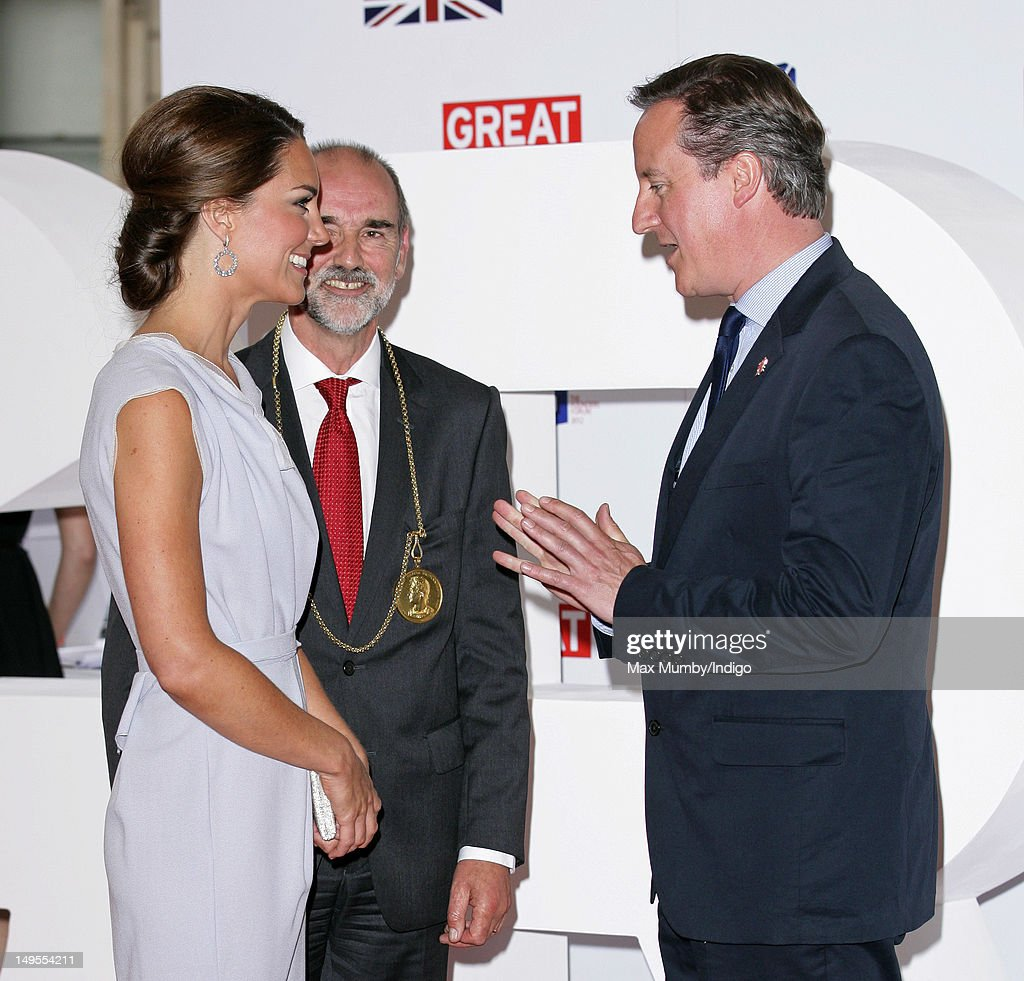 Catherine, Duchess of Cambridge is greeted by Prime Minister <a gi-track='captionPersonalityLinkClicked' href=/galleries/search?phrase=David+Cameron+-+Politician&family=editorial&specificpeople=227076 ng-click='$event.stopPropagation()'>David Cameron</a> as she attends The UK's Creative Industries Reception, as part of The British Government's GREAT campaign at the Royal Academy of Arts on July 30, 2012 in London, England.