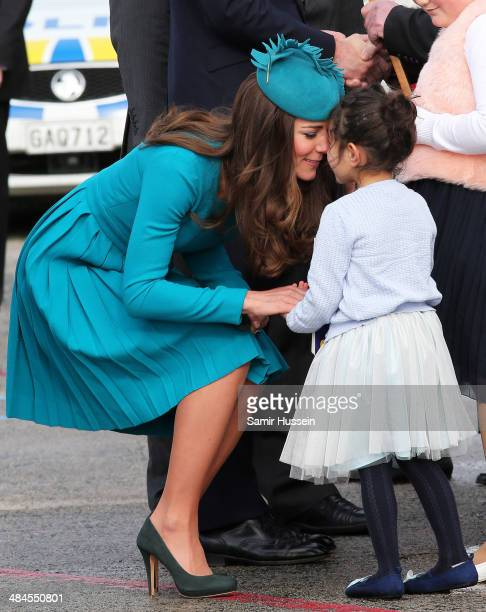 Catherine Duchess of Cambridge is greeted with a hongi by a girl as she arrives at Dunedin Airport on April 13 2014 in Dunedin New Zealand The Duke...