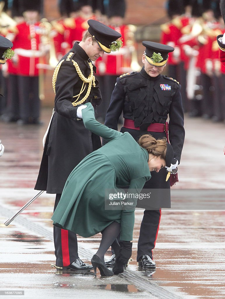 <a gi-track='captionPersonalityLinkClicked' href=/galleries/search?phrase=Catherine+-+Duchess+of+Cambridge&family=editorial&specificpeople=542588 ng-click='$event.stopPropagation()'>Catherine</a>, Duchess of Cambridge is helped by <a gi-track='captionPersonalityLinkClicked' href=/galleries/search?phrase=Prince+William&family=editorial&specificpeople=178205 ng-click='$event.stopPropagation()'>Prince William</a>, Duke of Cambridge as her heel gets stuck in the grating while attending The Irish Guards St Patricks Day Parade, at Mons Barracks on March 17, 2013 in Aldershot, England.