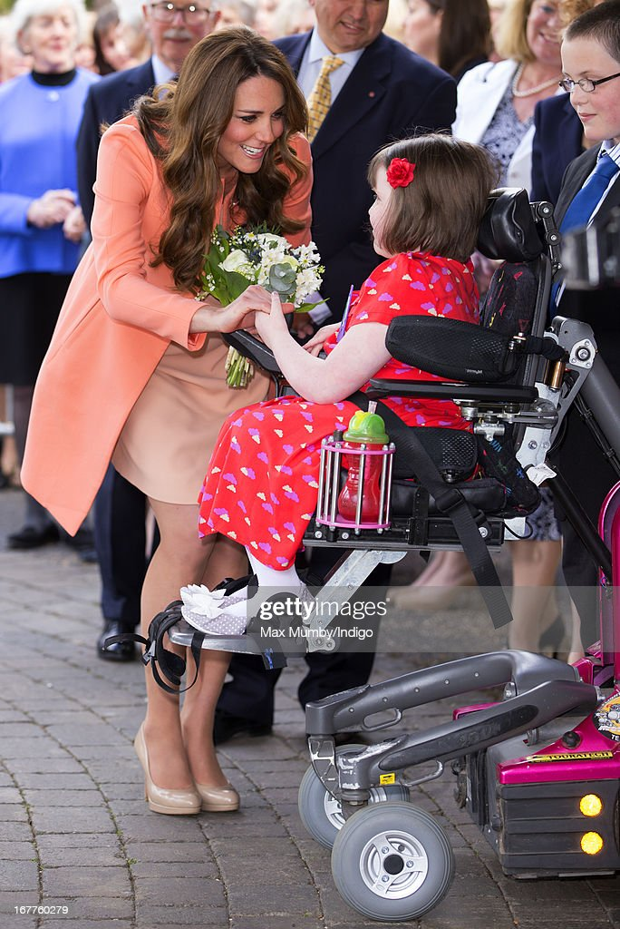 <a gi-track='captionPersonalityLinkClicked' href=/galleries/search?phrase=Catherine+-+Duchess+of+Cambridge&family=editorial&specificpeople=542588 ng-click='$event.stopPropagation()'>Catherine</a>, Duchess of Cambridge is presented with a posy of flowers by Sally Evans as she visits Naomi House Children's Hospice, to celebrate Children's Hospice Week 2013 on April 29, 2013 near Winchester, Hampshire, England. Today marks the second wedding anniversary of Prince William, Duke of Cambridge and <a gi-track='captionPersonalityLinkClicked' href=/galleries/search?phrase=Catherine+-+Duchess+of+Cambridge&family=editorial&specificpeople=542588 ng-click='$event.stopPropagation()'>Catherine</a>, Duchess of Cambridge. They married on April 29, 2011 in Westminster Abbey.