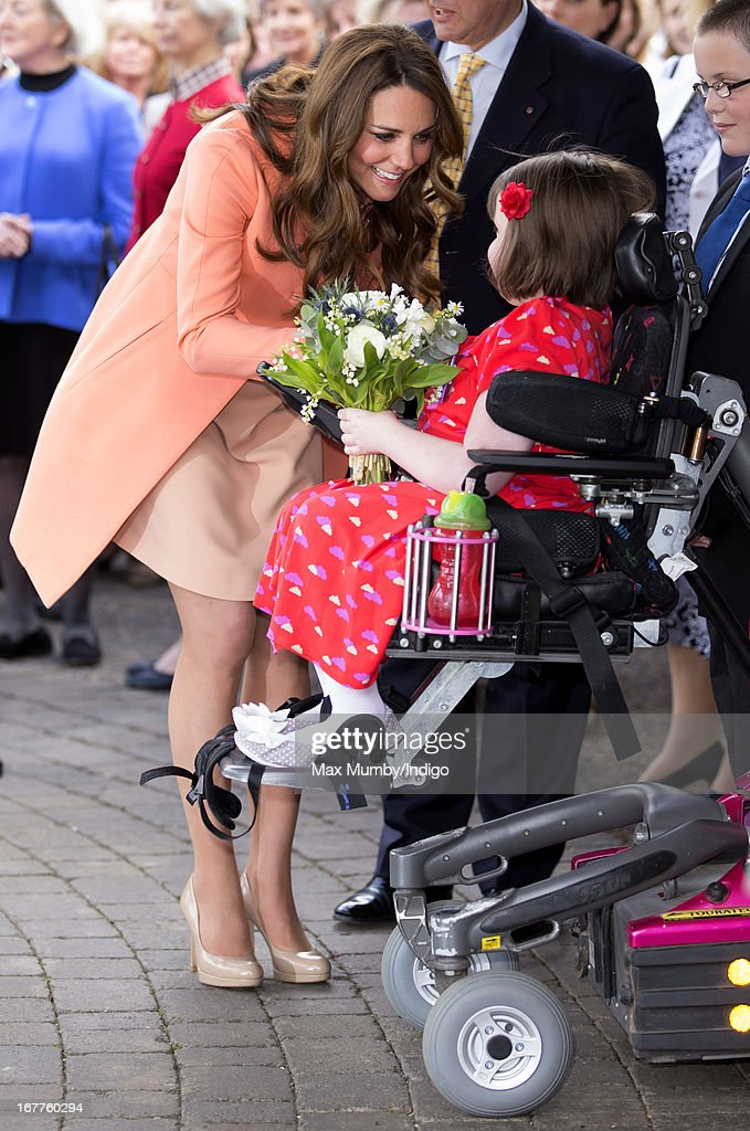 Catherine, Duchess of Cambridge is presented with a posy of flowers by Sally Evans as she visits Naomi House Children's Hospice, to celebrate Children's Hospice Week 2013 on April 29, 2013 near Winchester, Hampshire, England. Today marks the second wedding anniversary of Prince William, Duke of Cambridge and Catherine, Duchess of Cambridge. They married on April 29, 2011 in Westminster Abbey.