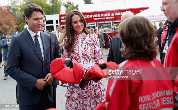 Catherine Duchess of Cambridge is presented with life jackets for Princess Charlotte and Prince George as Prime Minister Justin Trudeau looks on as...