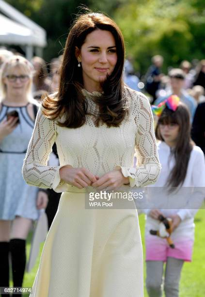 Catherine Duchess of Cambridge is seen as they host a tea party in the grounds of Buckingham Palace to honour the children of those who have died...