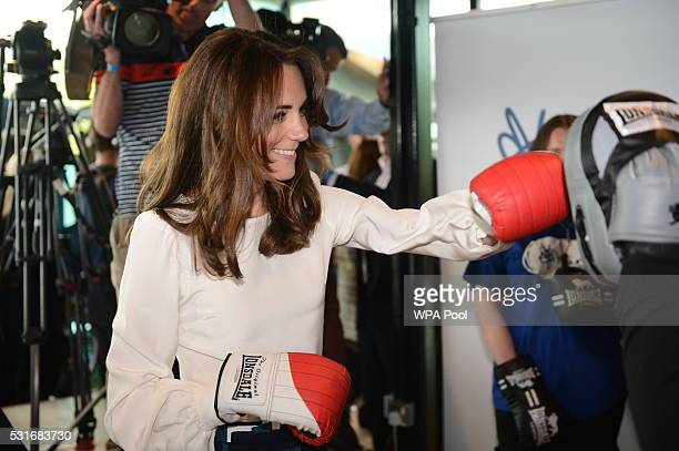 Catherine Duchess of Cambridge is seen boxing at Queen Elizabeth Olympic Park during the launch of the Heads Together campaign on mental health on...