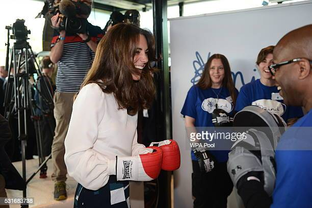Catherine Duchess of Cambridge is seen boxing with Duke McKenzie at Queen Elizabeth Olympic Park during the launch of the Heads Together campaign on...