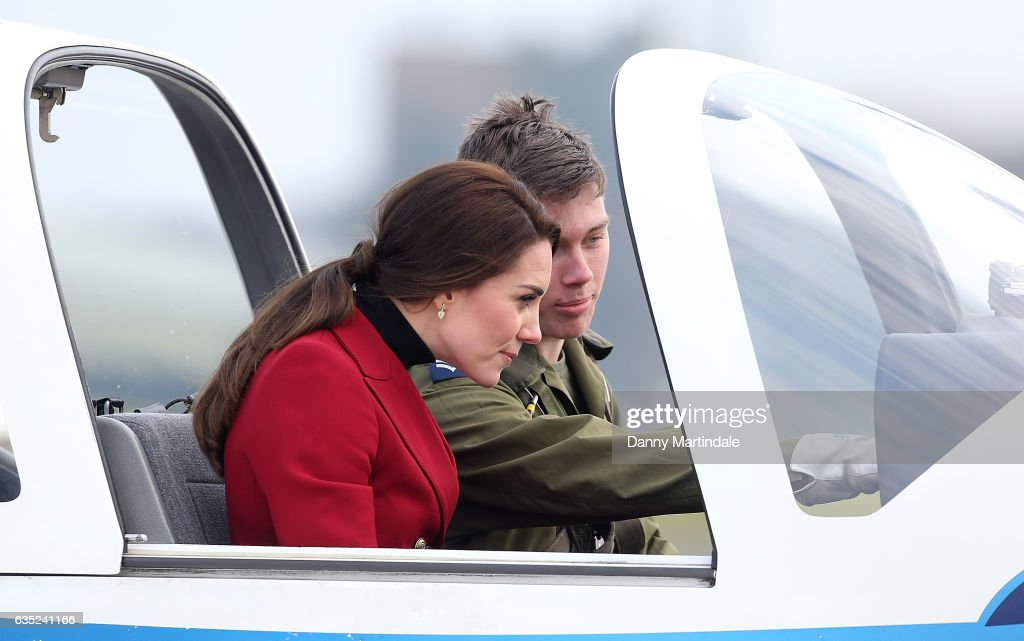 catherine-duchess-of-cambridge-is-seen-in-a-plane-during-a-visit-to-picture-id635241166