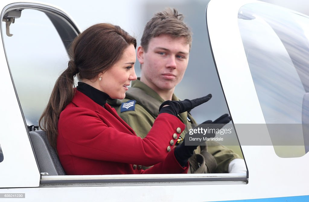catherine-duchess-of-cambridge-is-seen-in-a-plane-during-a-visit-to-picture-id635241230