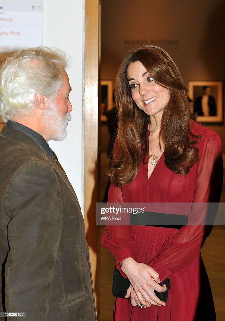 Catherine, Duchess of Cambridge is seen speaking to artist Paul Emsley after viewing his new portrait of herself during a private viewing at the National Portrait Gallery on January 11, 2013 in London, England.