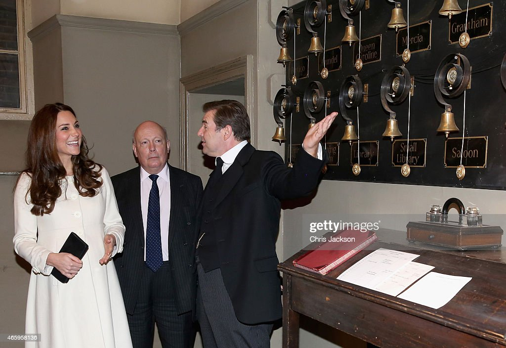 Catherine, Duchess of Cambridge is shown the Downton Abbey servants bells by actor Brendan Coyle (John Bates) during an official visit to the set of Downton Abbey at Ealing Studios on March 12, 2015 in London, England.