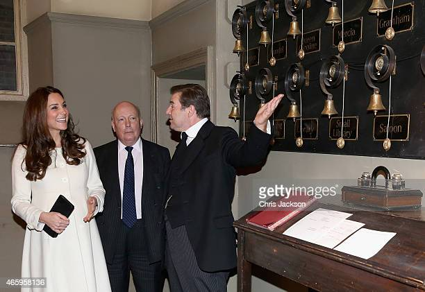 Catherine Duchess of Cambridge is shown the Downton Abbey servants bells by actor Brendan Coyle during an official visit to the set of Downton Abbey...