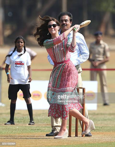 Catherine Duchess of Cambridge join a local cricket game during a visit to meet children from Magic Bus Childline and Doorstep three nongovernmental...