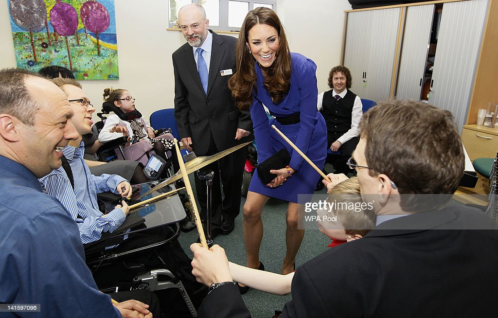 Catherine, Duchess of Cambridge joins in a music class during a visit to open The Treehouse Children's Hospice on March 19, 2012 in Ipswich, England.