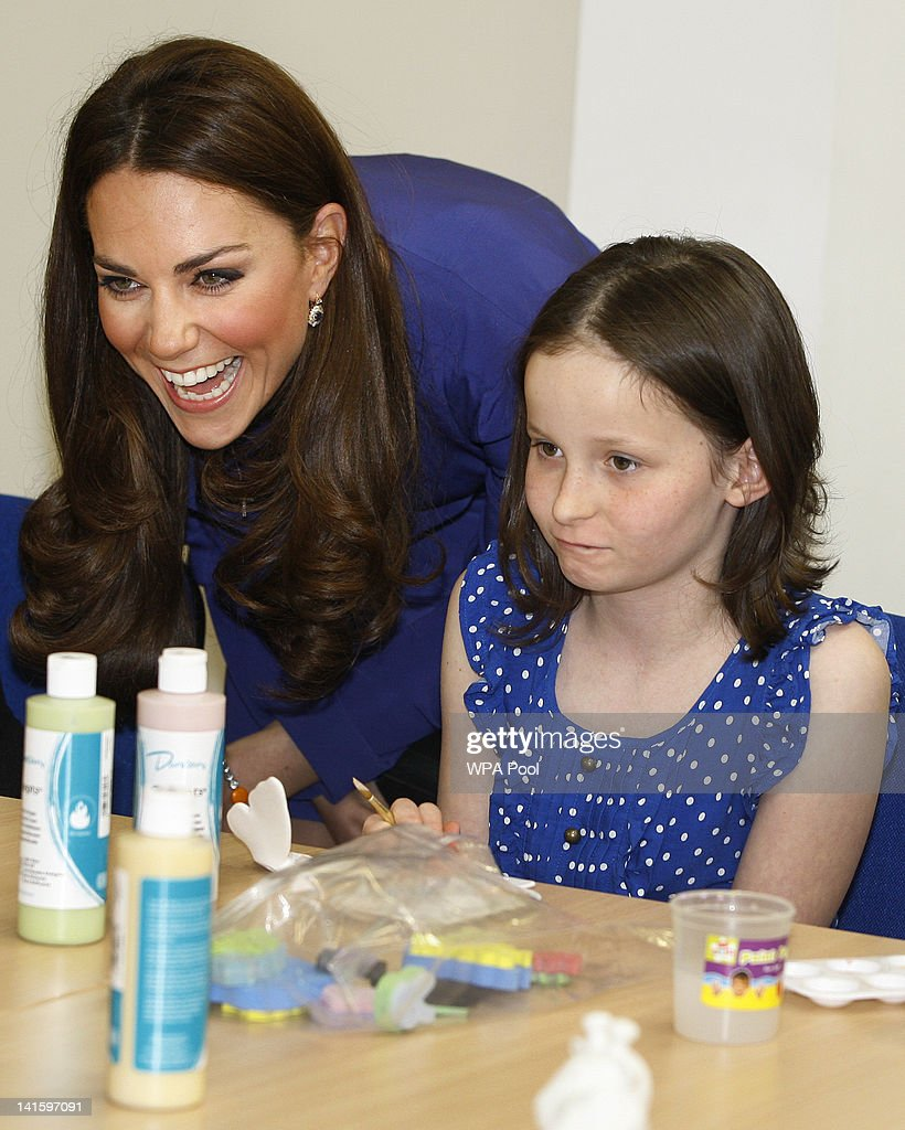 Catherine, Duchess of Cambridge joins in an art class with Abbi Clarke during a visit to open The Treehouse Children's Hospice on March 19, 2012 in Ipswich, England.