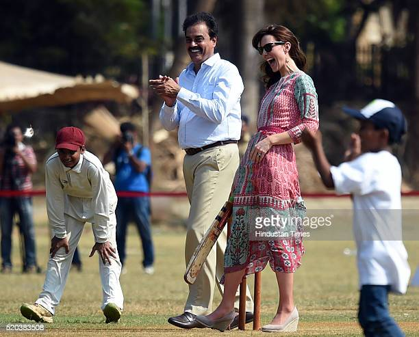 Catherine Duchess Of Cambridge known as Kate Middleton before her marriage and former Indian cricketer Dilip Vengsarkar enjoy a game of cricket at...