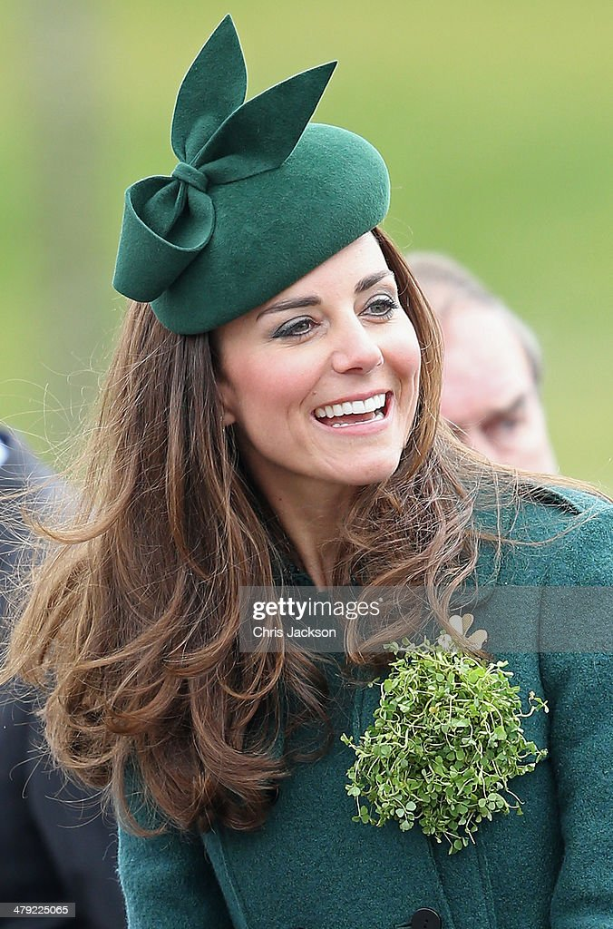 Catherine, Duchess of Cambridge laughs as she attends the St Patrick's Day parade at Mons Barracks on March 17, 2014 in Aldershot, England. Catherine, Duchess of Cambridge and Prince William, Duke of Cambridge visited the 1st Battalion Irish Guards to present the traditional sprigs of Shamrocks to the Officers and Guardsmen of the Regiment.