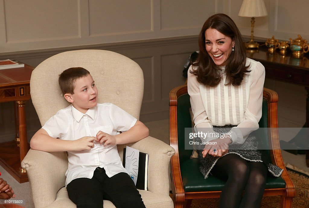 Catherine, Duchess of Cambridge laughs as she chats to Hayden Pearce from the 'Real Truth' video blog that features on the Huffington Post website at Kensington Palace on February 17, 2016 in London, England. The Duchess of Cambridge is supporting the launch of the Huffington Post UK's initiative 'Young Minds Matter' by guest editing the Huffington Post UK today from Kensington Palace.
