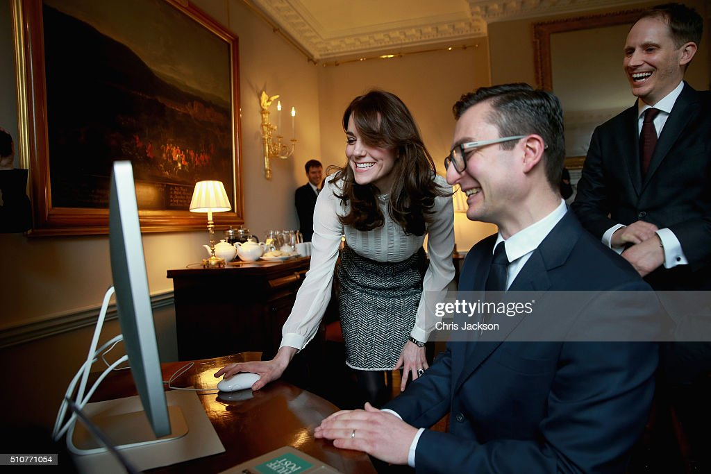 Catherine, Duchess of Cambridge launches a story on 'Early Intervention in Mental Health Care' watched by James Martin (Executive Editor Huff Post UK) and Steven Hull (Editor in Chief Huff Post UK) on the Huffington Post landing page in the 'News Room' at Kensington Palace on February 17, 2016 in London, England. The Duchess of Cambridge is supporting the launch of the Huffington Post UK's initiative 'Young Minds Matter' by guest editing the Huffington Post UK today from Kensington Palace.
