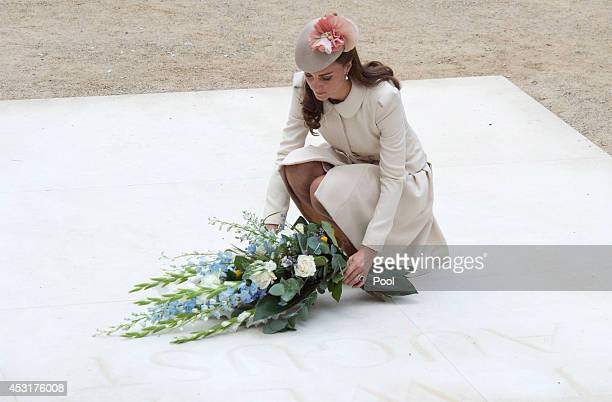 Catherine Duchess of Cambridge lays a floral tribute at St Symphorien Military Cemetery on August 4 2014 in Mons Belgium Monday 4th August marks the...