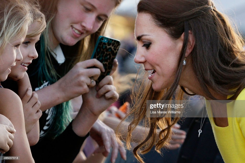 Catherine, Duchess of Cambridge leans in close to speak with some young fans at the Sydney Opera House on April 16, 2014 in Sydney, Australia. The Duke and Duchess of Cambridge are on a three-week tour of Australia and New Zealand, the first official trip overseas with their son, Prince George of Cambridge.