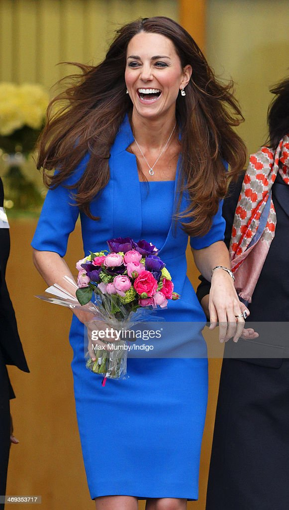 Catherine, Duchess of Cambridge leaves Northolt High School after officially opening The ICAP Art Room on February 14, 2014 in Ealing, England.