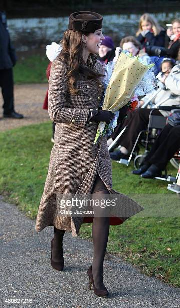 Catherine Duchess of Cambridge leaves the Christmas Day Service at Sandringham Church on December 25 2014 in King's Lynn England