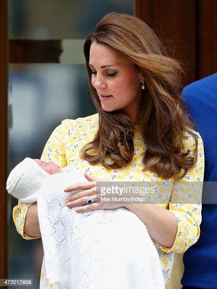 Catherine Duchess of Cambridge leaves the Lindo Wing with her newborn daughter at St Mary's Hospital on May 2 2015 in London England The Duchess...