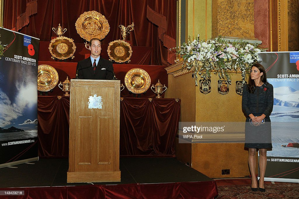 Catherine, Duchess of Cambridge listens as her husband, Prince Willaim, Duke of Cambridge, delivers a speech at a Reception For The Scott-Amundsen Centenary Race at Goldsmiths Hall on April 26, 2012 in London, England.