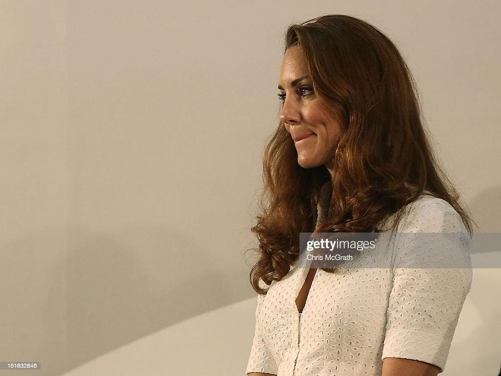 Catherine, Duchess of Cambridge listens on as Prince William, Duke of Cambridge gives a speech during the tour of the Rolls-Royce Seletar Campus during the Diamond Jubilee tour on September 12, 2012 at Seletar Aerospace Park in Singapore.