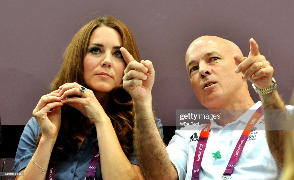 Catherine, Duchess of Cambridge listens to John Brewer, chairman of the British Handball Association during the Women's Handball Preliminaries Group A match between Great Britain and Croatia on Day 9 of the London 2012 Olympic Games at the Copper Box on August 5, 2012 in London, England.