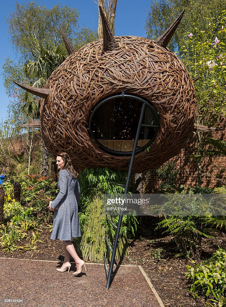 Catherine, Duchess of Cambridge looks at a 'Dragons nest' play area as she officially opens The Magic Garden at Hampton Court Palace on May 4, 2016 in London, England.