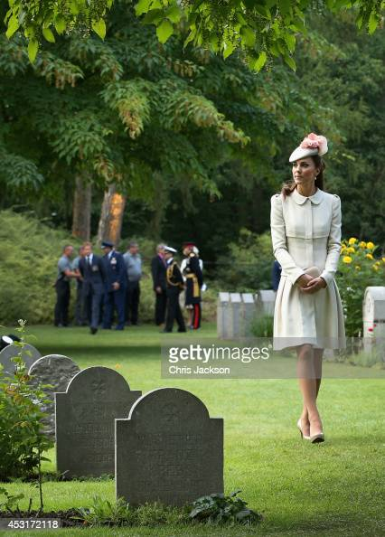 Catherine Duchess of Cambridge looks at war graves at St Symphorien Military Cemetery on August 4 2014 in Mons Belgium Monday 4th August marks the...