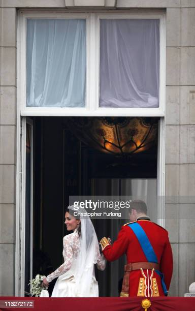 Catherine Duchess of Cambridge looks back as Prince William Duke of Cambridge takes her from the balcony at Buckingham Palace on April 29 2011 in...