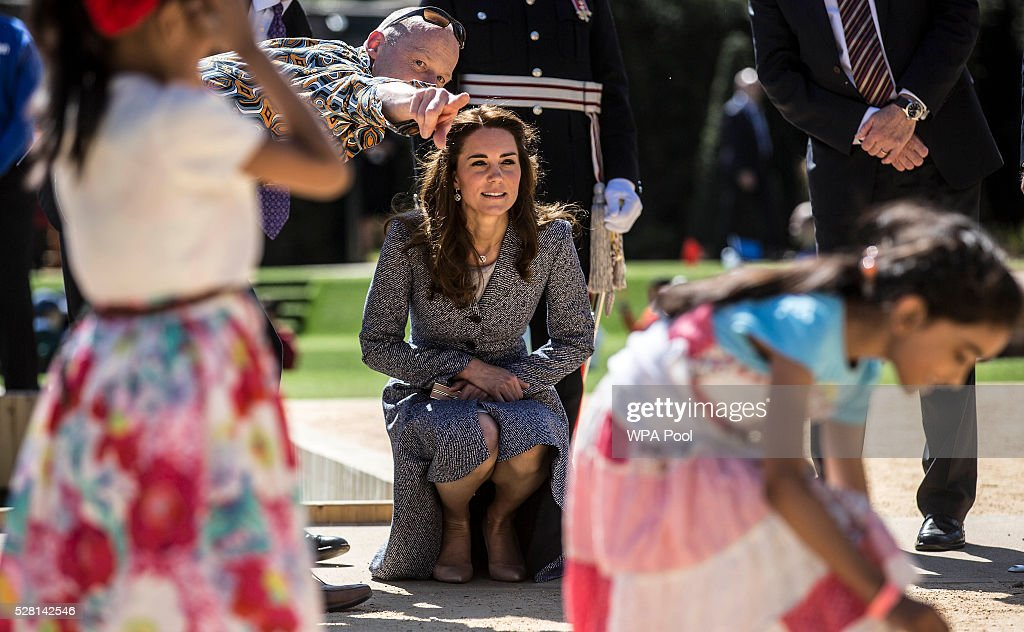 <a gi-track='captionPersonalityLinkClicked' href=/galleries/search?phrase=Catherine+-+Duchess+of+Cambridge&family=editorial&specificpeople=542588 ng-click='$event.stopPropagation()'>Catherine</a>, Duchess of Cambridge looks on as children play as she officially opens The Magic Garden at Hampton Court Palace on May 4, 2016 in London, England.