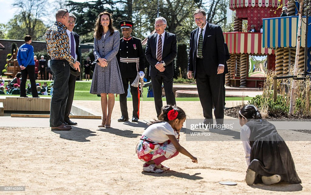 <a gi-track='captionPersonalityLinkClicked' href=/galleries/search?phrase=Catherine+-+Duchessa+di+Cambridge&family=editorial&specificpeople=542588 ng-click='$event.stopPropagation()'>Catherine</a>, Duchess of Cambridge looks on as children play as she officially opens The Magic Garden at Hampton Court Palace on May 4, 2016 in London, England.