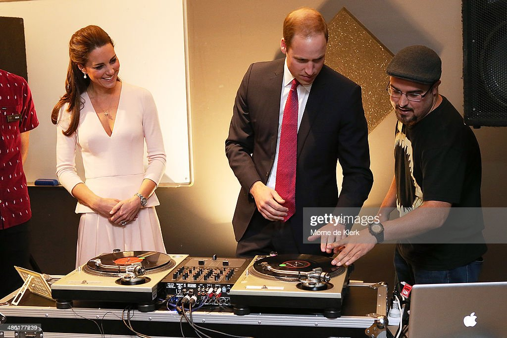 Catherine, Duchess of Cambridge looks on as Prince William, Duke of Cambridge is shown how to play on DJ decks at the youth community centre, The Northern Sound System in Elizabeth on April 23, 2014 in Adelaide, Australia. The Duke and Duchess of Cambridge are on a three-week tour of Australia and New Zealand, the first official trip overseas with their son, Prince George of Cambridge.