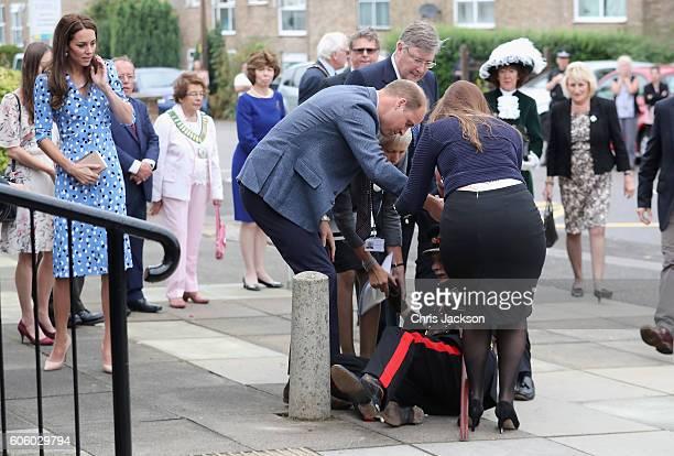 Catherine Duchess of Cambridge looks on as Prince William Duke of Cambridge rushes to helpVice Lord Lieutenant of Essex Jonathon DouglasHughes who...
