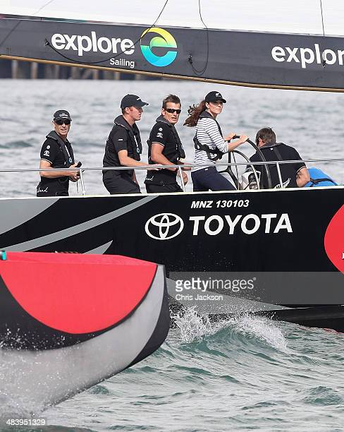 Catherine Duchess of Cambridge looks to the bow of Prince William Duke of Cambridge's America's Cup yacht as she races Prince William Duke of...