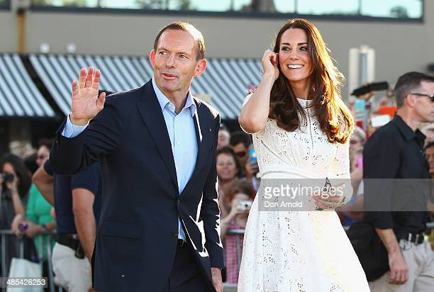 Catherine Duchess of Cambridge makes her way onto Manly Beach alongside Tony Abbott on April 18 2014 in Sydney Australia The Duke and Duchess of...