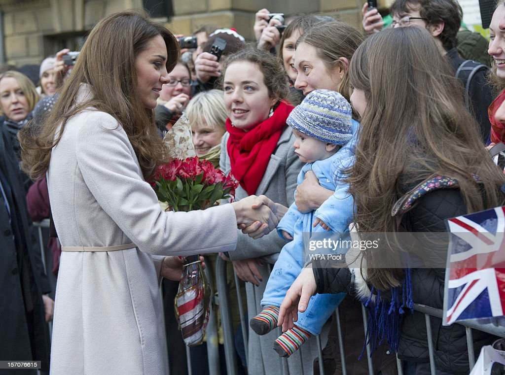 Catherine, Duchess of Cambridge meets 5 month-old James William Davies, who was named after Prince William, and his mother Tessa Davies in the Market Square during an official visit to the Guildhall on November 28, 2012 in Cambridge, England.